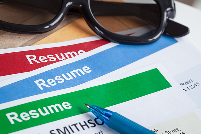 Resume_letter_background_and_glasses,_pen,_can_use_as_recruitmen