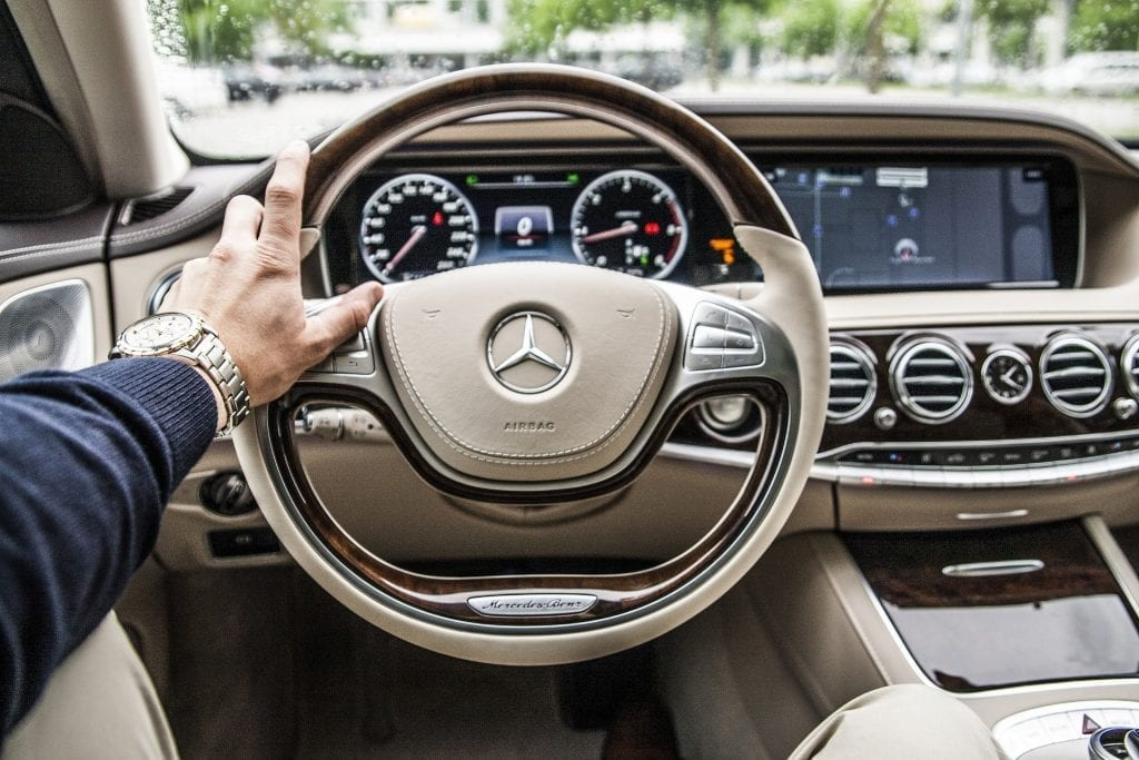a point of view image of a person sitting in a car automotive marketing blog